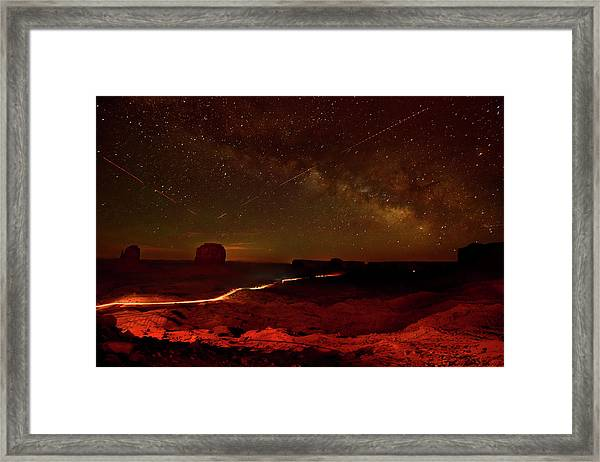 Headlights And Buttes In Monument Framed Print