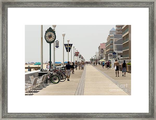 Heat Waves Make The Boardwalk Shimmer In The Distance Framed Print
