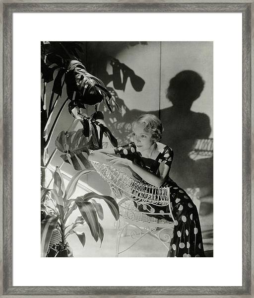 Helen Hayes Sitting By A Potted Plant Framed Print