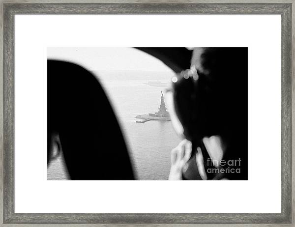 Helicopter  Flies Over Statue Of Liberty As Seen Through The Plexiglas New York Framed Print by Joe Fox