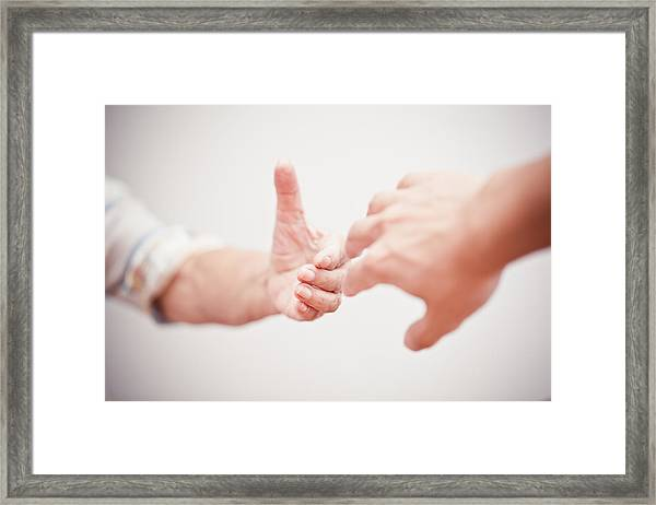 Helping Hand Framed Print by Fzant
