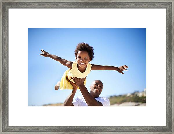 Helping His Daughter Soar! Framed Print by PeopleImages
