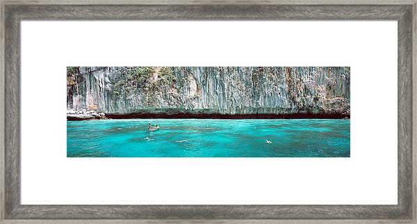 High Angle View Of Three People Framed Print