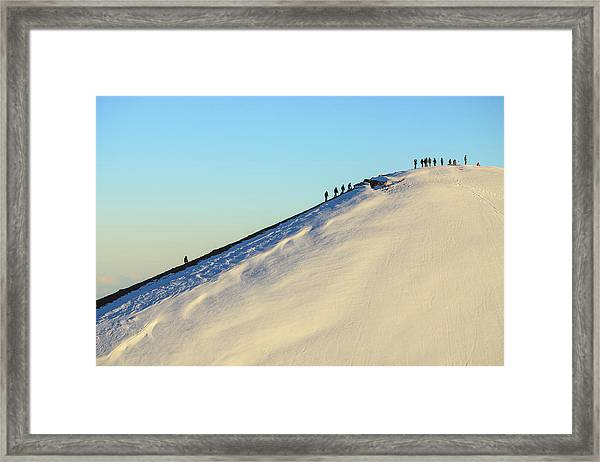 Hikers Climbing Snowy Mountain Framed Print