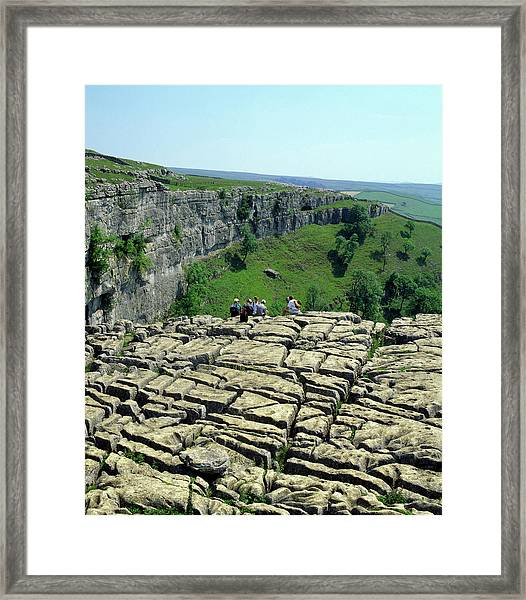 Hikers On Limestone Pavement Framed Print