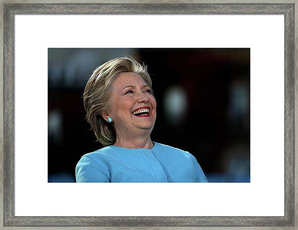 Hillary Clinton Is Joined By Maggie Framed Print