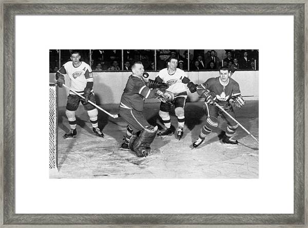 Hockey Goalie Chin Stops Puck Framed Print