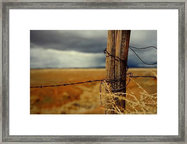 Hold Back The Storm Framed Print