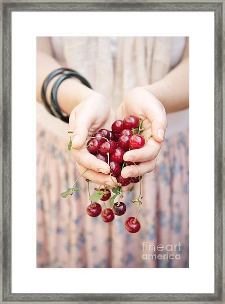 Holding Cherries  Framed Print
