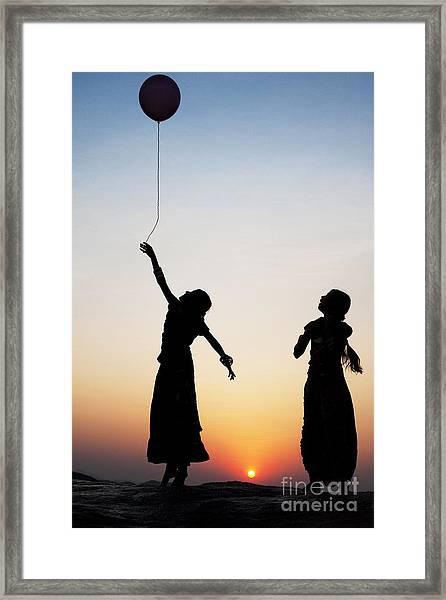 Holding The Dream Framed Print