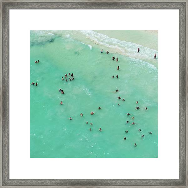 Holiday Makers Cooling Off In The Sea Framed Print
