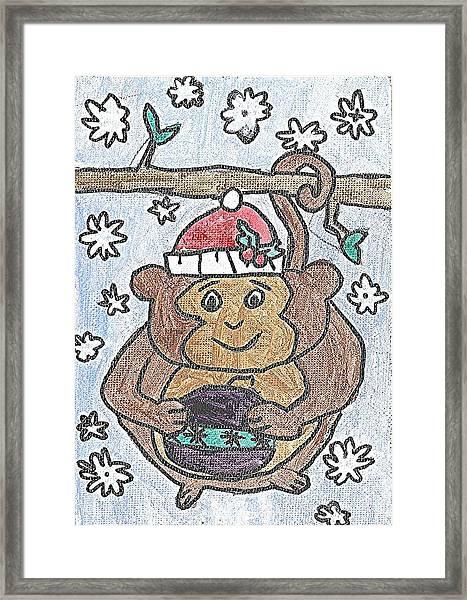 Holiday Monkey Framed Print by Fred Hanna
