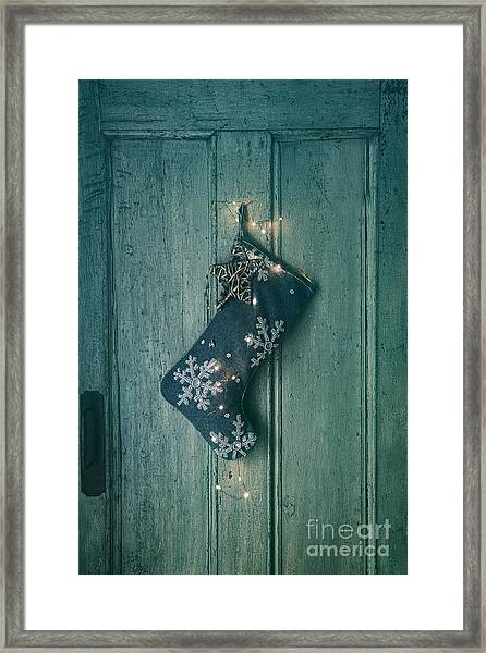 Holiday Stocking With Lights Hanging On Old Door Framed Print