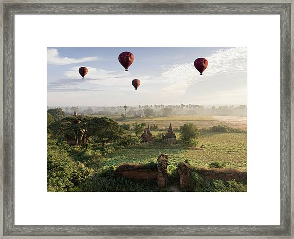 Hot Air Balloons Flying Over Ancient Framed Print by Martin Puddy