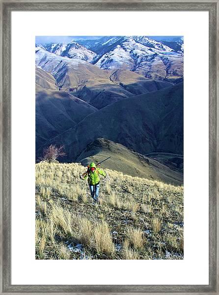 Hunter Climbing Steep Hillside Framed Print
