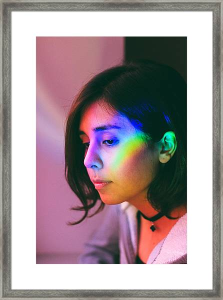 Illuminated Light Falling On Thoughtful Woman Face Framed Print by Camilo Fuentes Beals / EyeEm