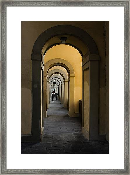 In A Distance - Vasari Corridor In Florence Italy  Framed Print