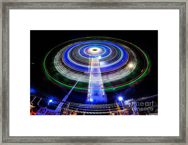 In A Spin Framed Print