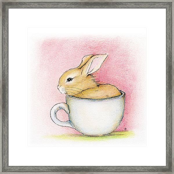 In A Tea Cup Framed Print