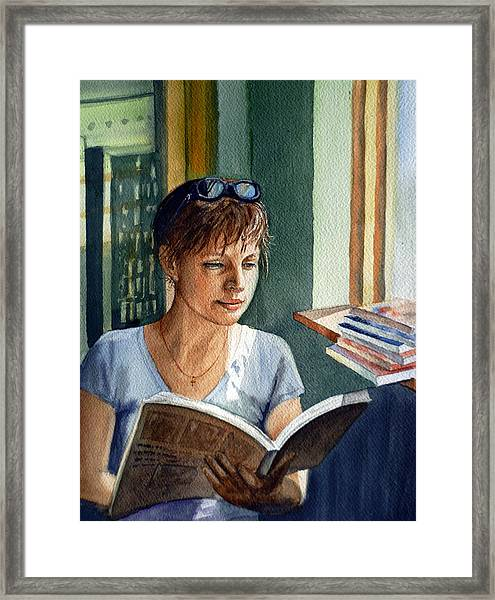 In The Book Store Framed Print