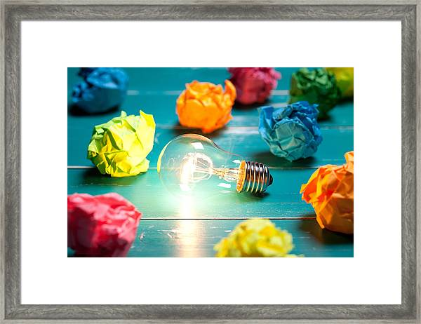 Incandescent Bulb And Colorful Notes On Turquoise Wooden Table Framed Print by Xxmmxx