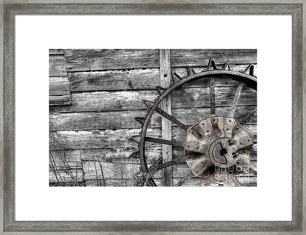 Iron Tractor Wheel Framed Print