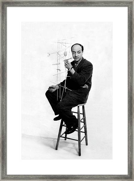 Isamu Noguchi Holding One Of His Structures Framed Print by Herbert Matter