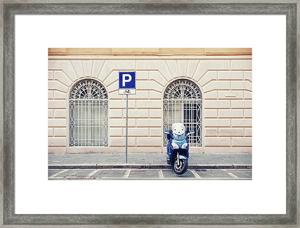 Italian Scooter Parked On The Street Framed Print
