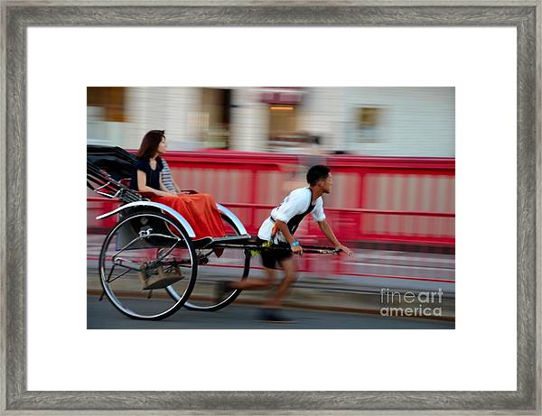 Japanese Tourists Ride Rickshaw In Tokyo Japan Framed Print