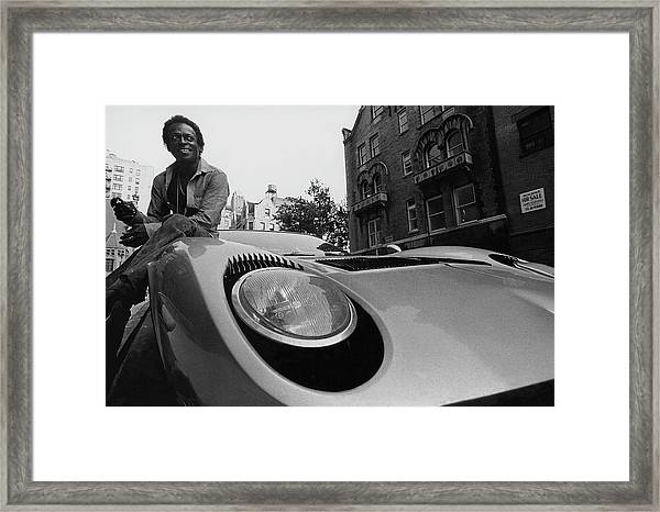 Jazz Musician Miles Davis Sitting On The Hood Framed Print