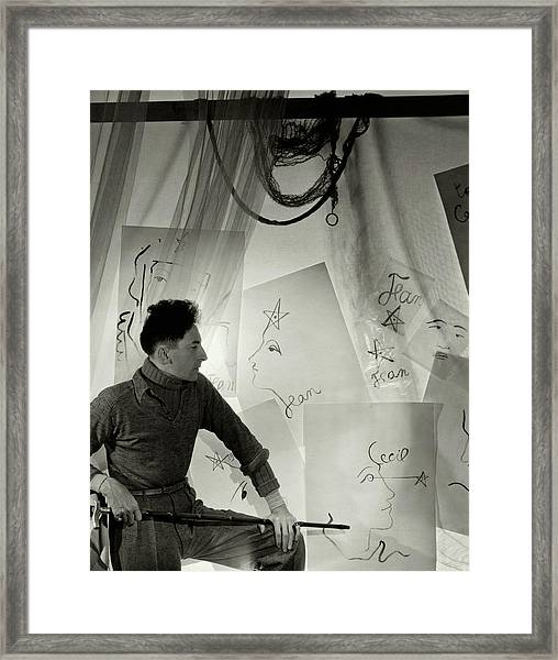 Jean Cocteau With A Cane And Drawings Framed Print by Cecil Beaton