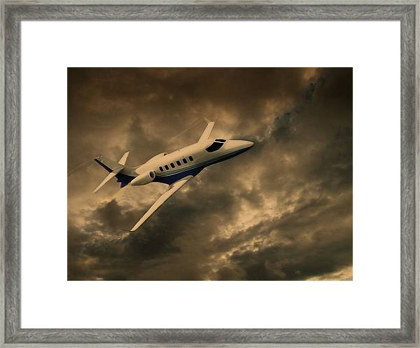 Framed Print featuring the photograph Jet Through The Clouds by David Dehner