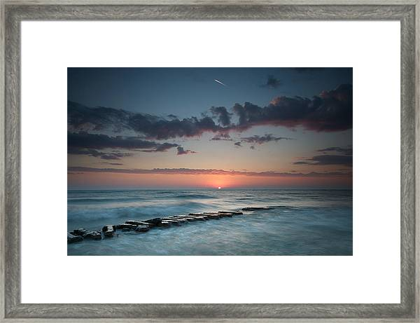 Jetty And The Sun Framed Print