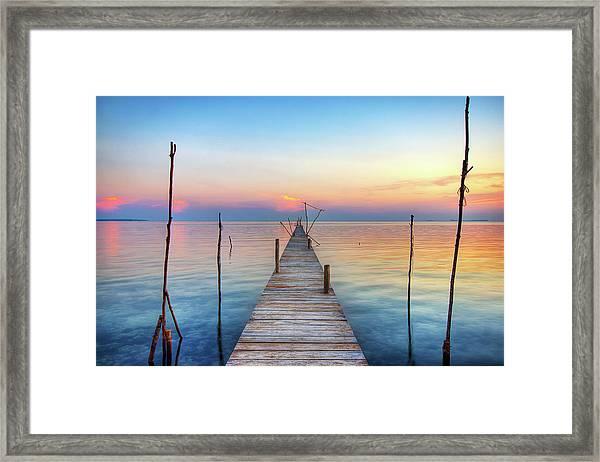 Jetty At Sunset Framed Print