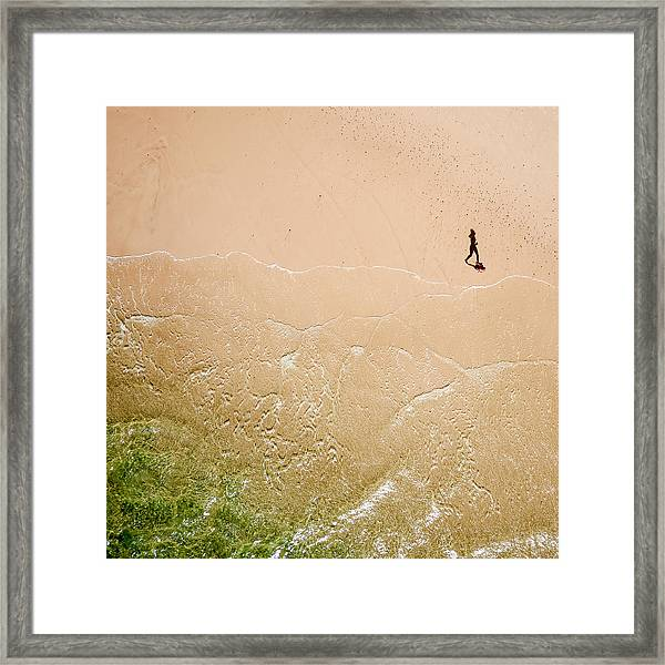 Jogger On Tallow Beach. Byron Bay. Australia. Framed Print