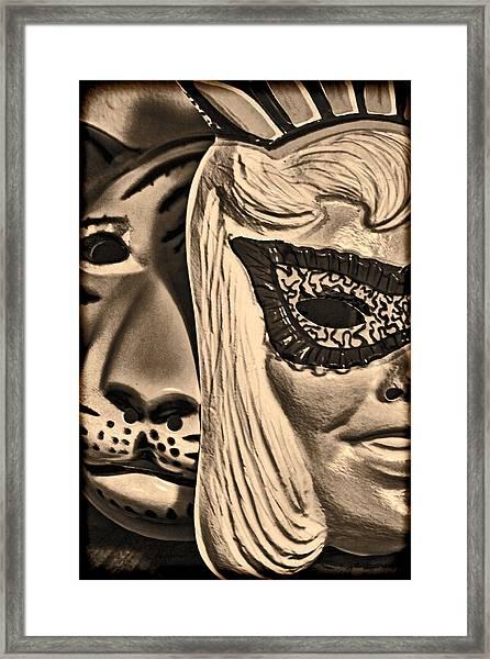 Joking Masks Framed Print