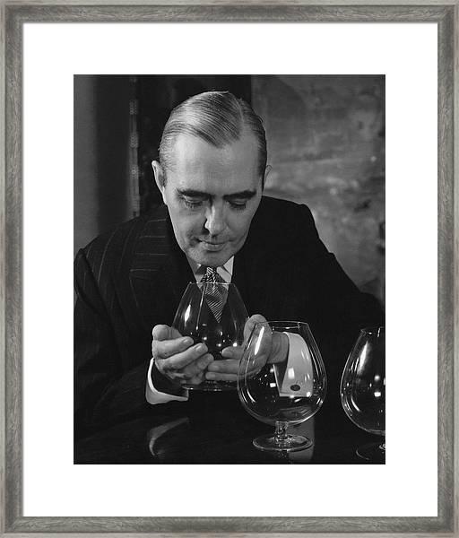 Julian Street Holding A Brandy Snifter Framed Print