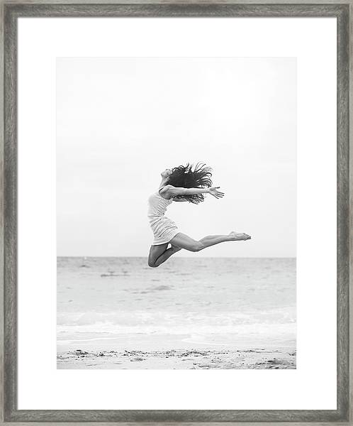 Jumping At The Beach Framed Print