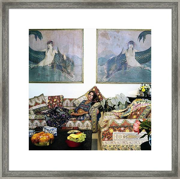 Justine Cushing On Her Sofa Framed Print