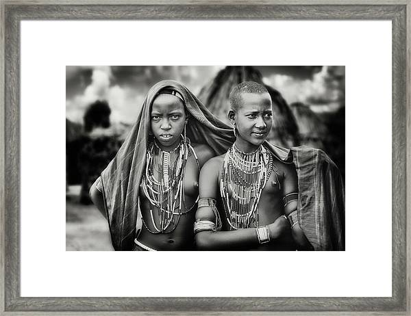 Karo Girls Sharing A Scarf Framed Print by Piet Flour