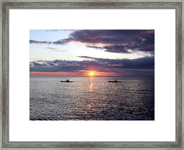 Kayaks At Sunset Framed Print
