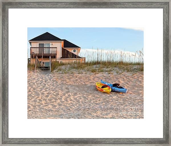 Kayaks Rest On Sand Dune In Morning Sun. Framed Print
