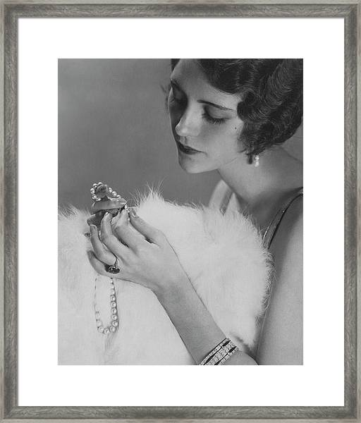 Kendall Lee Holding A Pearl Necklace Framed Print