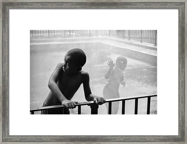 Kid In Sprinkler Framed Print