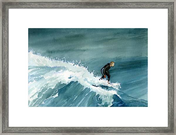 Kid Riding Wave Framed Print