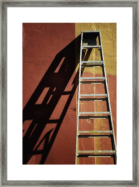 Ladder And Shadow On The Wall Framed Print