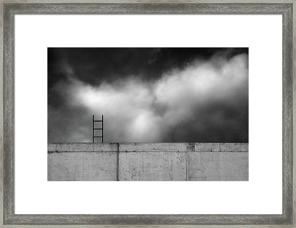 Ladder And Wall... Framed Print