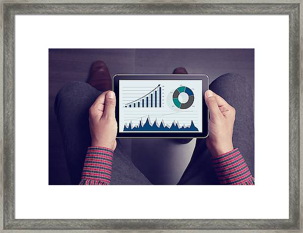 Lap Point Of View Of Man Holding Tablet Framed Print by Triloks