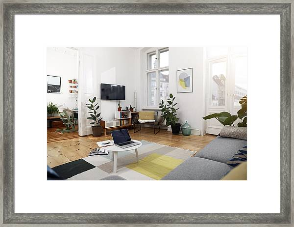 Laptop On A Coffee Table In A Modernly Furnished Flat Framed Print by Westend61