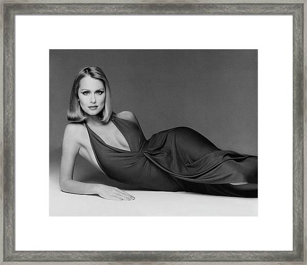 Laura Hutton Wearing A Halston Dress Framed Print by Francesco Scavullo